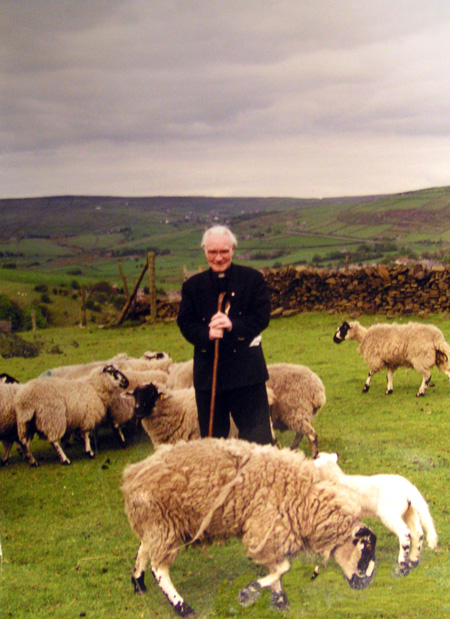 Fr-Joe-with-sheep.jpg